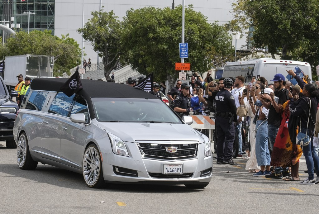 The hearse carrying rapper Nipsey Hussle leaves the Staples Center after a memorial service in Los Angeles, Thursday, April 11, 2019. Hussle was kille