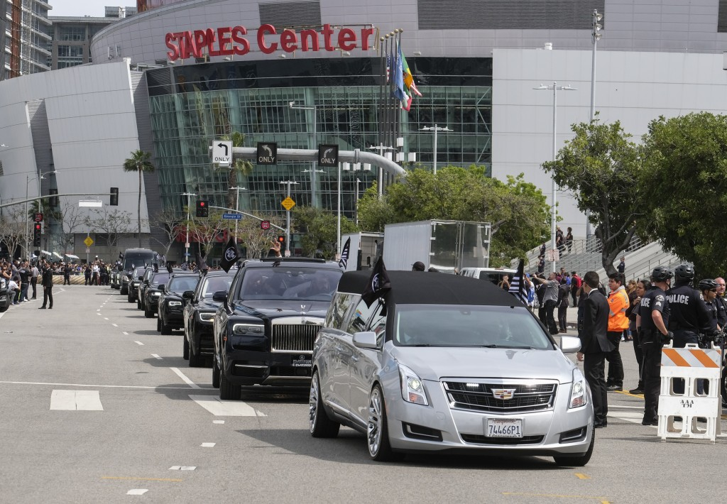 The hearse carrying rapper Nipsey Hussle leaves Staples Center after a memorial service in Los Angeles, Thursday, April 11, 2019. Hussle was killed in