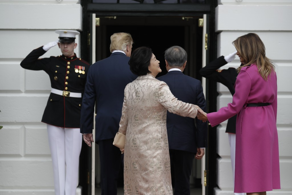 President Donald Trump and first lady Melania Trump greet South Korean President Moon Jae-in and his wife Kim Jung-sook on the South Lawn of the White