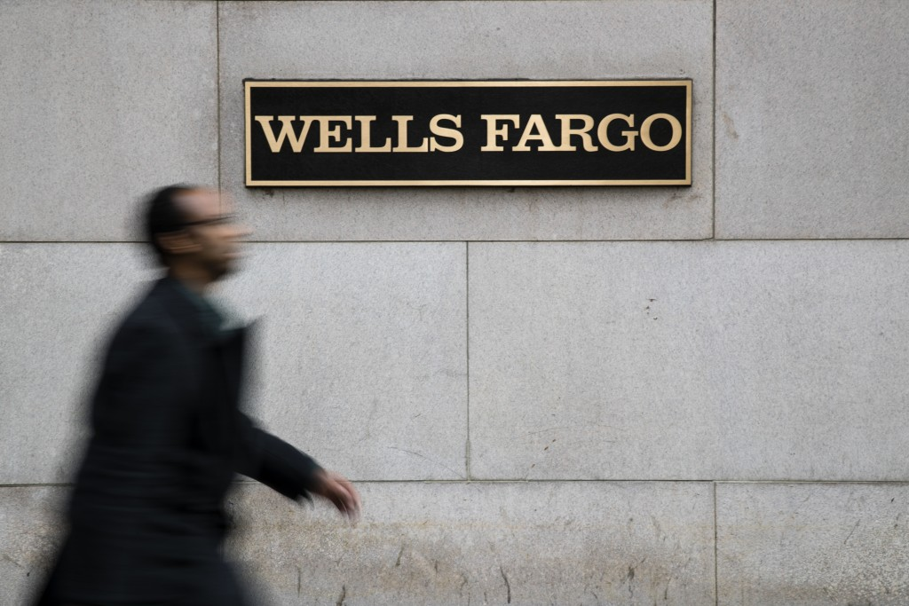Wells Fargo shares fall as bank cuts forecast for interest income