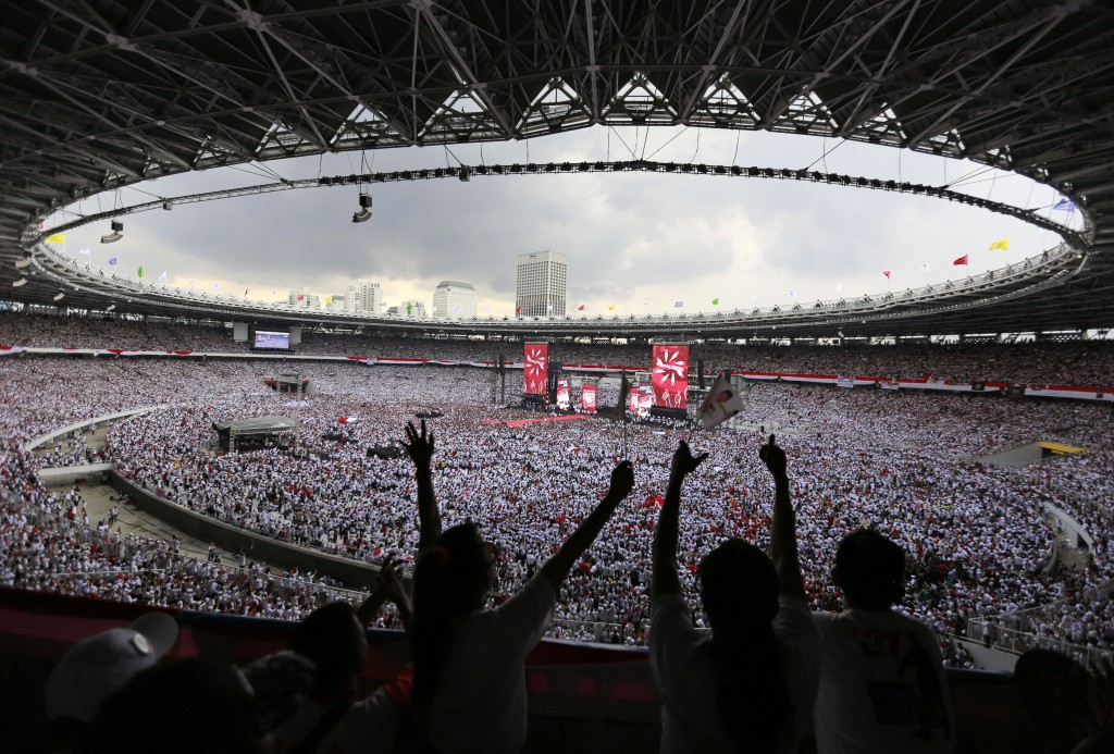 In this Saturday, April 13, 2019, file photo, supporters cheer during the campaign rally of Indonesian President Joko Widodo at Gelora Bung Karno Stad
