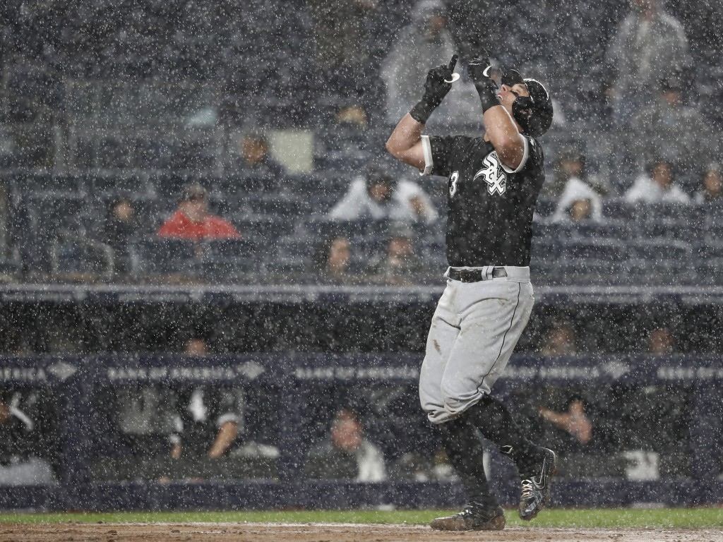 Chicago White Sox James McCann approaches the plate after hitting a home run against the New York Yankees during the seventh inning of a baseball game...