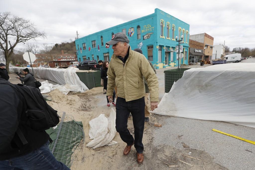 2020 Democratic presidential candidate Washington Gov. Jay Inslee tours flood damage, Friday, April 12, 2019, in Hamburg, Iowa. (AP Photo/Charlie Neib