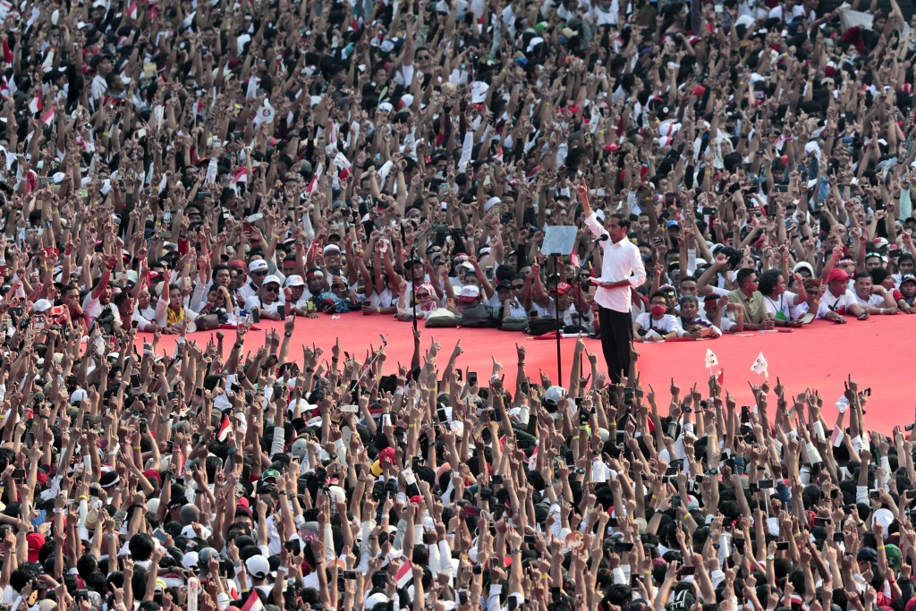 In this Saturday, April 13, 2019, file photo, Indonesian President Joko Widodo delivers a speech during his campaign rally at Gelora Bung Karno Stadiu