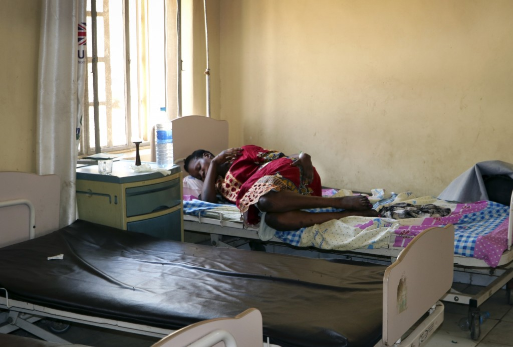 In this photo taken Monday, March 11, 2019, a pregnant woman lies on a bed in the maternity ward of the Juba Teaching Hospital, in the capital Juba, S...