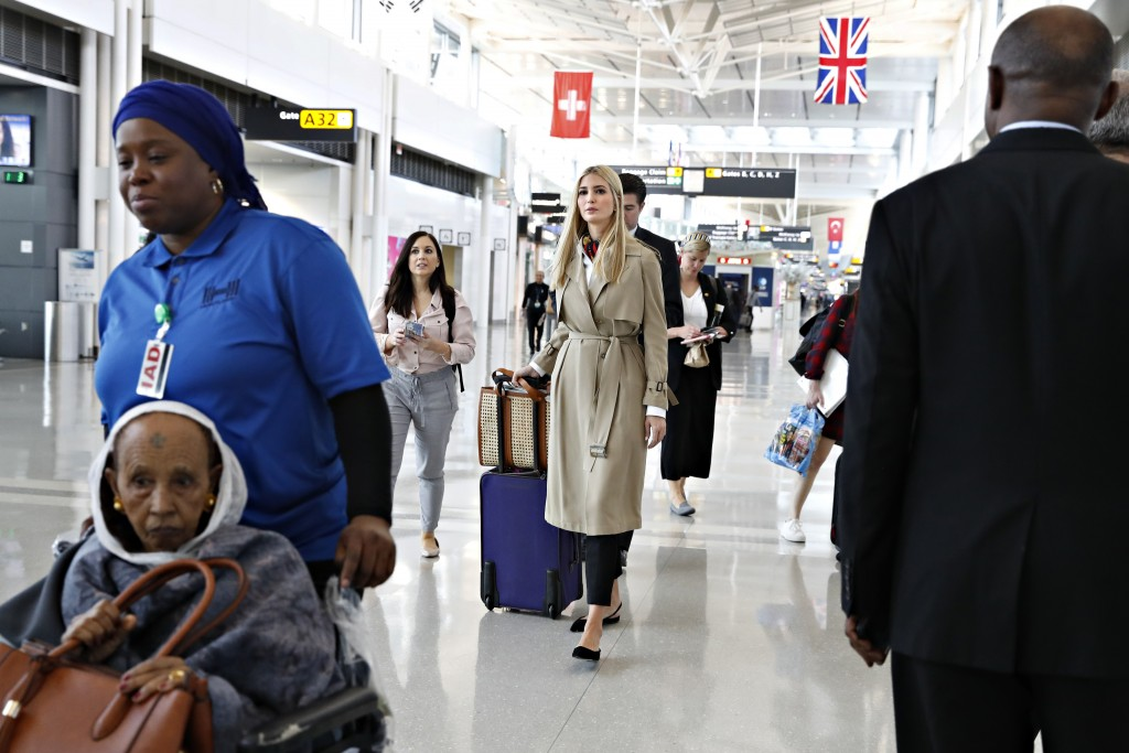 Ivanka Trump, center, walks through a terminal of Dulles International Airport, in Sterling, Va., Saturday April 13, 2019, to board a flight to Ethiop...