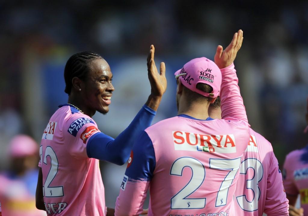 Rajasthan Royals' Jofra Archer celebrates the dismissal of Mumbai Indians' Rohit Sharma during the VIVO IPL T20 cricket match between Mumbai Indians a