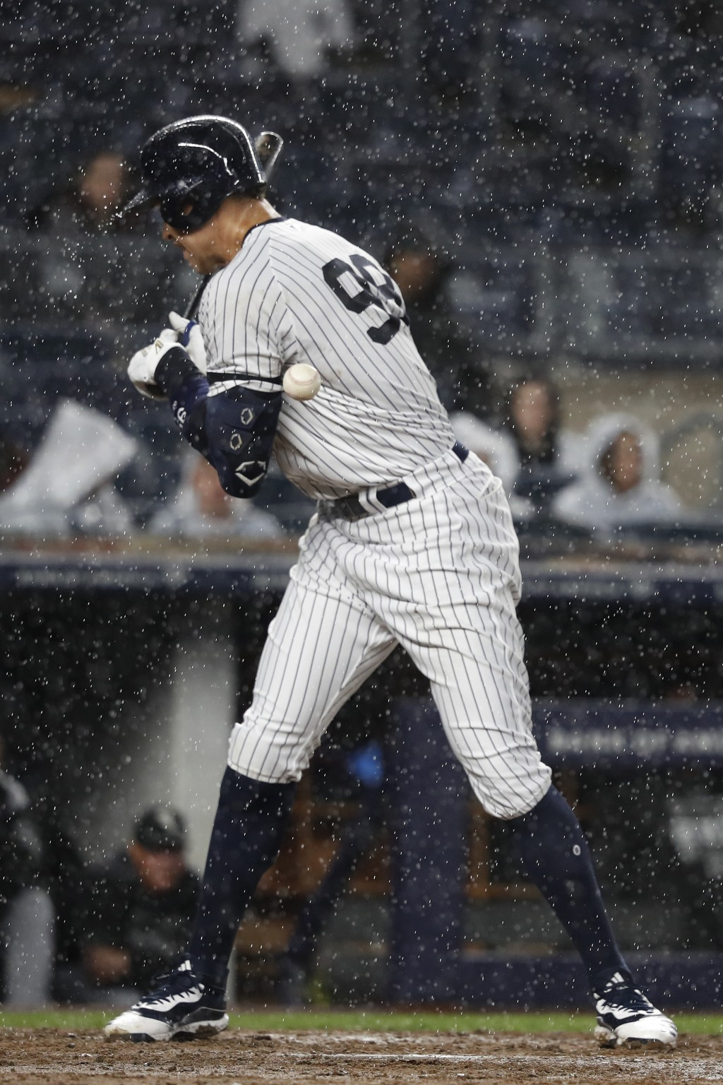 New York Yankees Aaron Judge is hit by a pitch thrown by Chicago White Sox reliever Nate Jones during the sixth inning of a baseball game Friday, Apri