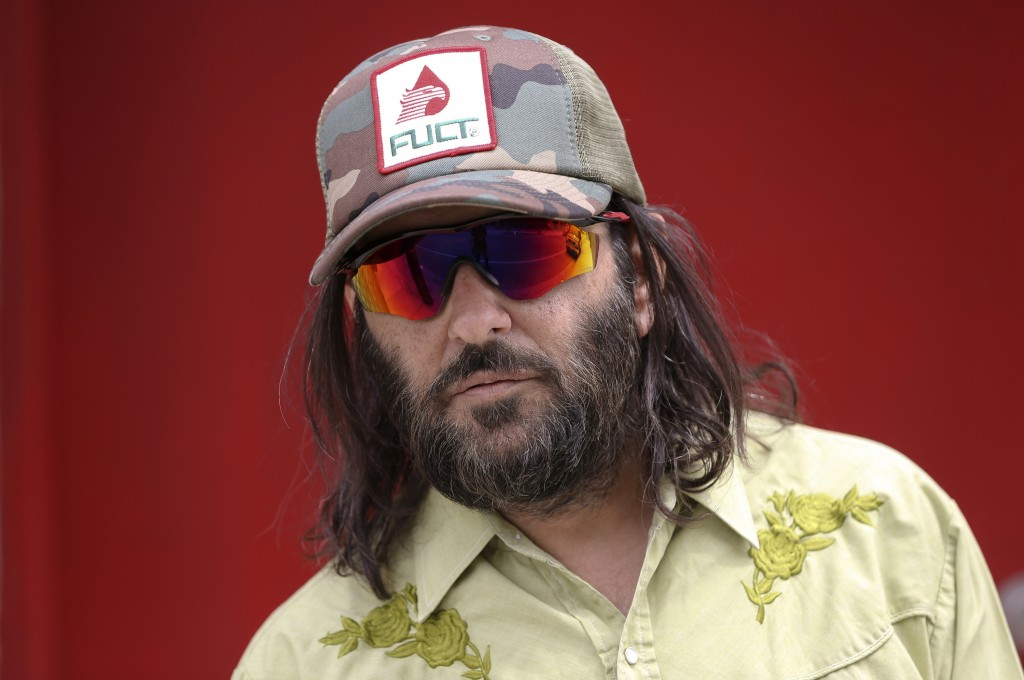 """Los Angeles artist Erik Brunetti, the founder of the streetwear clothing company """"FUCT,"""" poses for a photo in Los Angeles Thursday, April, 11, 2019. """""""