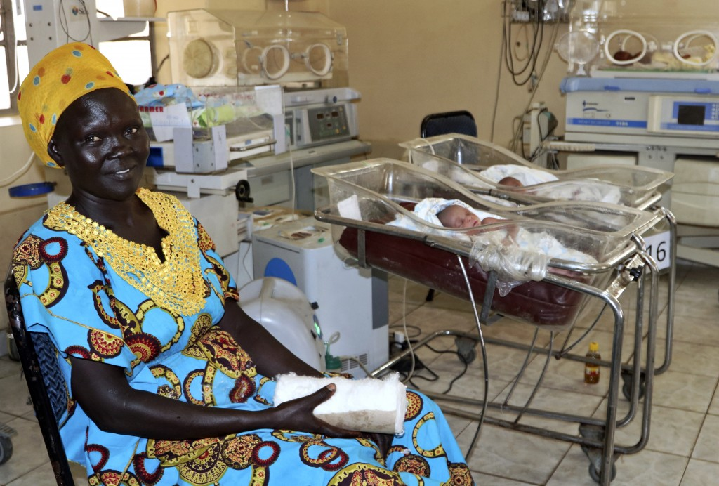 In this photo taken Monday, March 11, 2019, a mother sits beside her newborn in the ward for premature babies at the Juba Teaching Hospital, in the ca...