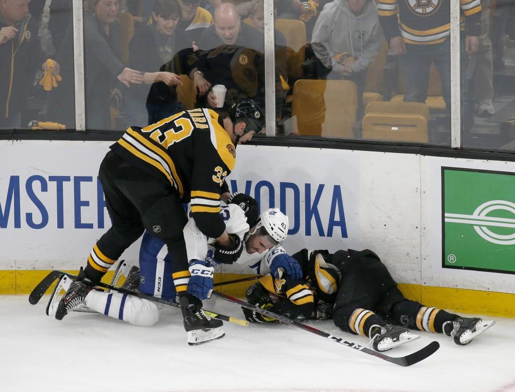 Boston Bruins defenseman Zdeno Chara (33) pulls Toronto Maple Leafs center Nazem Kadri (43) off teammate Jake DeBrusk (74) after Kadri hit DeBrusk int
