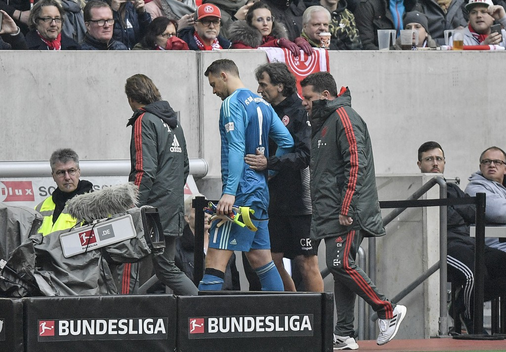Bayern goalkeeper Manuel Neuer leaves the pitch injured during the German Bundesliga soccer match between Fortuna Duesseldorf and Bayern Munich in Due