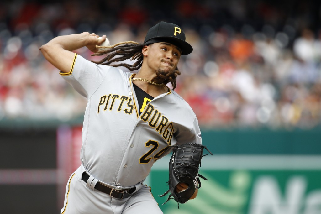 Pittsburgh Pirates starter Chris Archer throws to the Washington Nationals in the third inning of a baseball game, Saturday, April 13, 2019, in Washin...