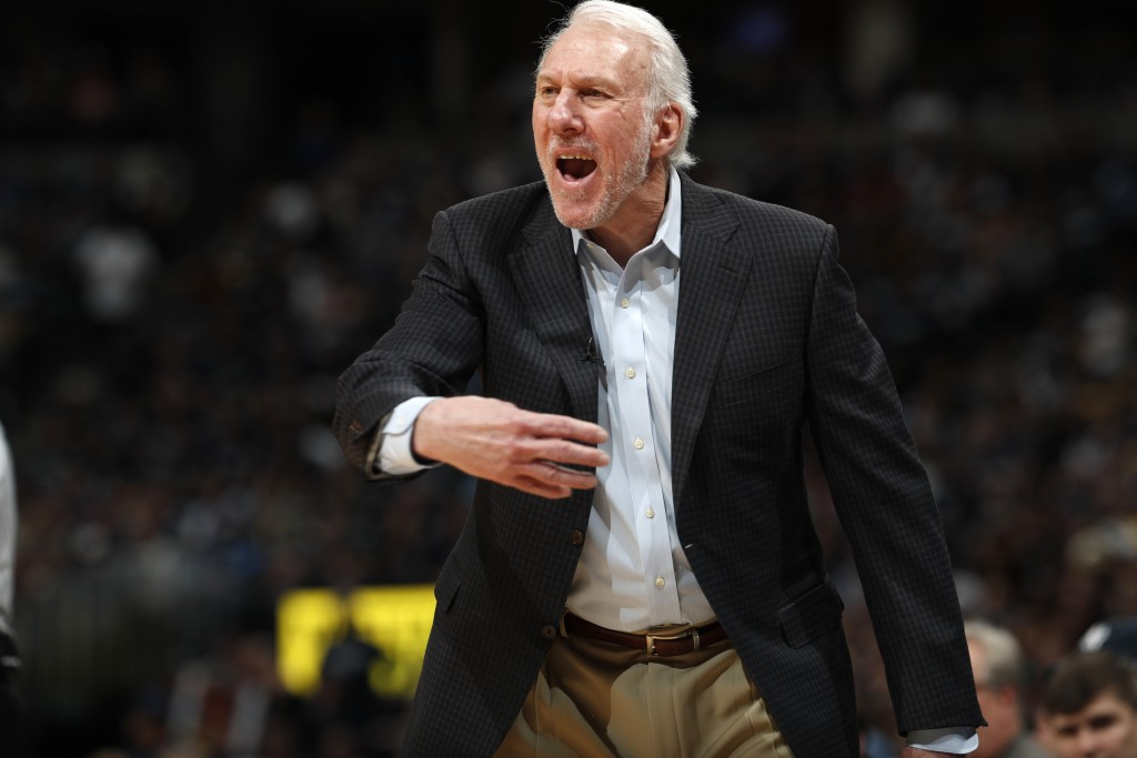 San Antonio Spurs head coach Gregg Popovich directs his team against the Denver Nuggets in the second half of Game 1 of an NBA first-round basketball