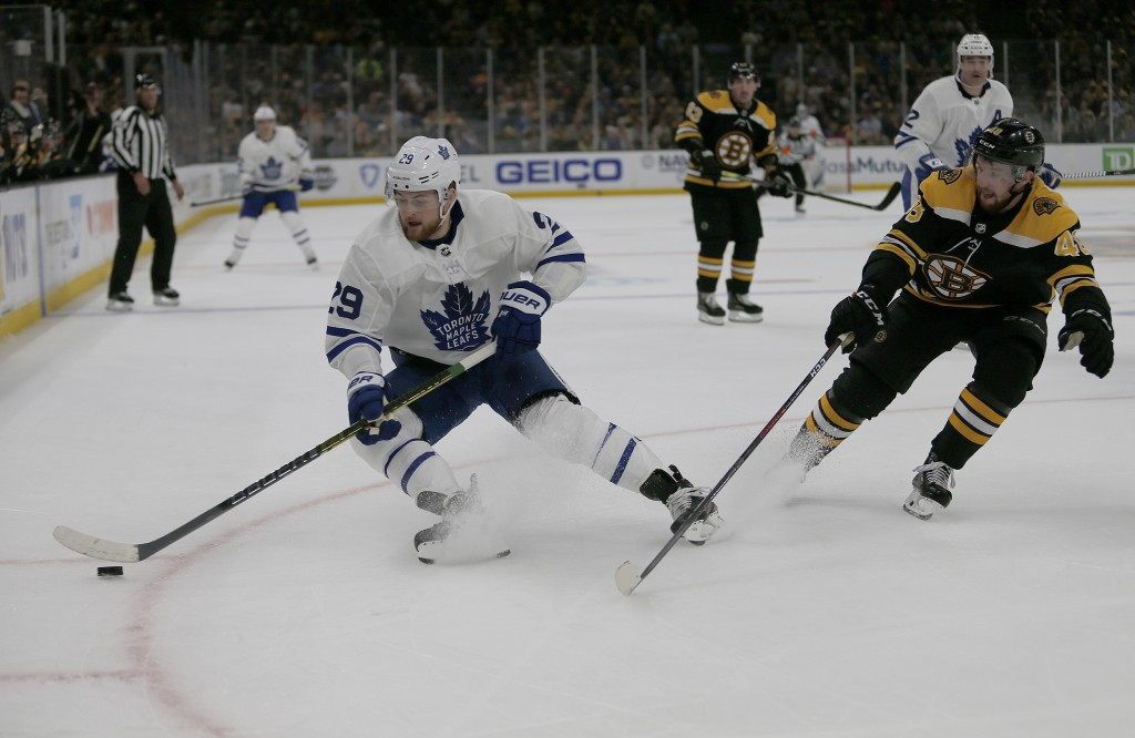 Toronto Maple Leafs right wing William Nylander (29) controls the puck ahead of Boston Bruins defenseman Matt Grzelcyk (48) during the first period of