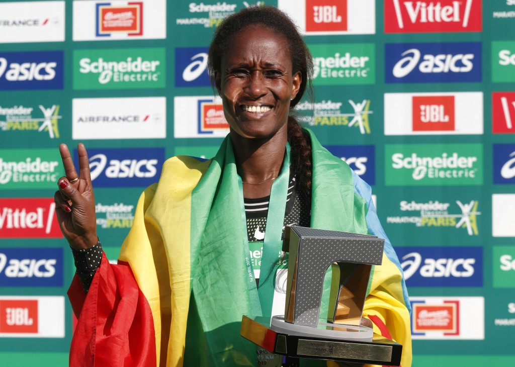 Gelete Burka of Ethiopia holds up the winners trophy after she won the women's Paris Marathon in a time of 2 hours 22 minutes 47 seconds in Paris, Fra