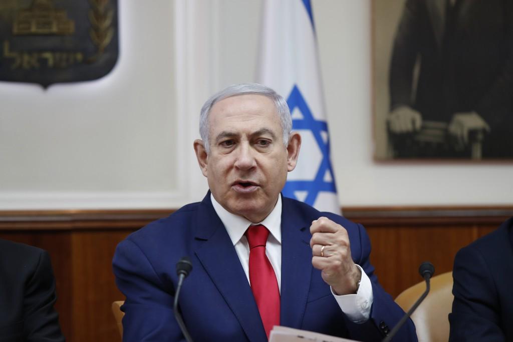 Israeli Prime Minister Benjamin Netanyahu chairs the weekly cabinet meeting in Jerusalem, Sunday, April 14, 2019. (Ronen Zvulun/Pool via AP)