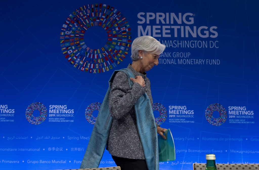International Monetary Fund (IMF) Managing Director Christine Lagarde leaves after a news conference, after the International Monetary and Financial C...