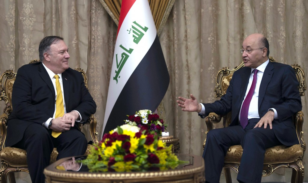 FILE - In this Jan. 9, 2019 file photo, US Secretary of State Mike Pompeo, left, meets with Iraqi President Barham Salih, in Baghdad, Iraq. Iraq is se...