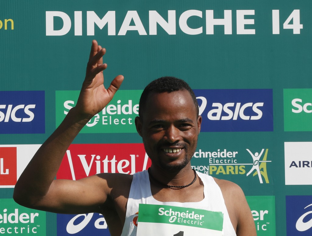 Abrha Milaw of Ethiopia celebrates after he won the man's Paris Marathon with a time of 2 hours 7 minutes and 5 seconds in Paris, France, Sunday, Apri