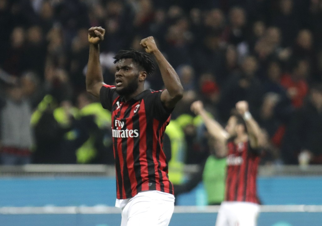 AC Milan's Franck Kessie, left, reacts at the end of the Serie A soccer match between AC Milan and Lazio, at the San Siro stadium in Milan, Italy, Sat...