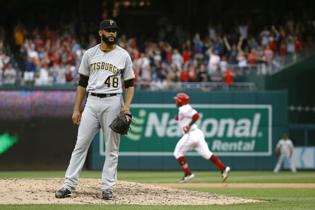 Pittsburgh Pirates relief pitcher Richard Rodriguez (48) stands on the mound as Washington Nationals' Howie Kendrick rounds the bases on a solo home r...
