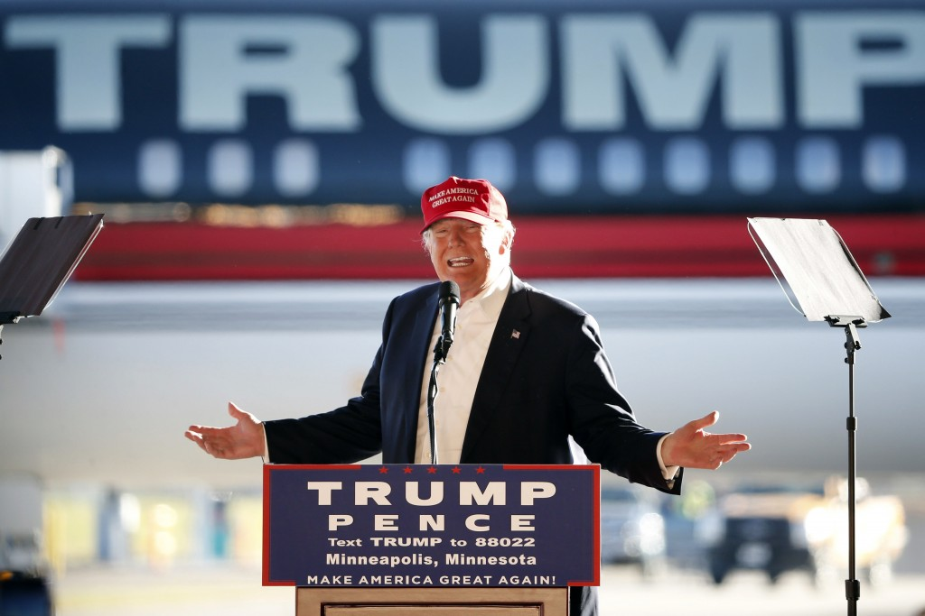 FILE - In this Sunday, Nov. 6, 2016 file photo, Republican presidential candidate Donald Trump addresses the crowd during a campaign stop at the Minne