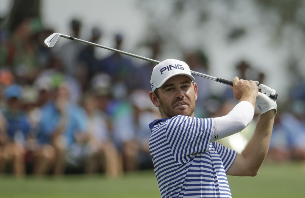 Louis Oosthuizen, of South Africa, hits from the third tee during the third round for the Masters golf tournament Saturday, April 13, 2019, in Augusta...