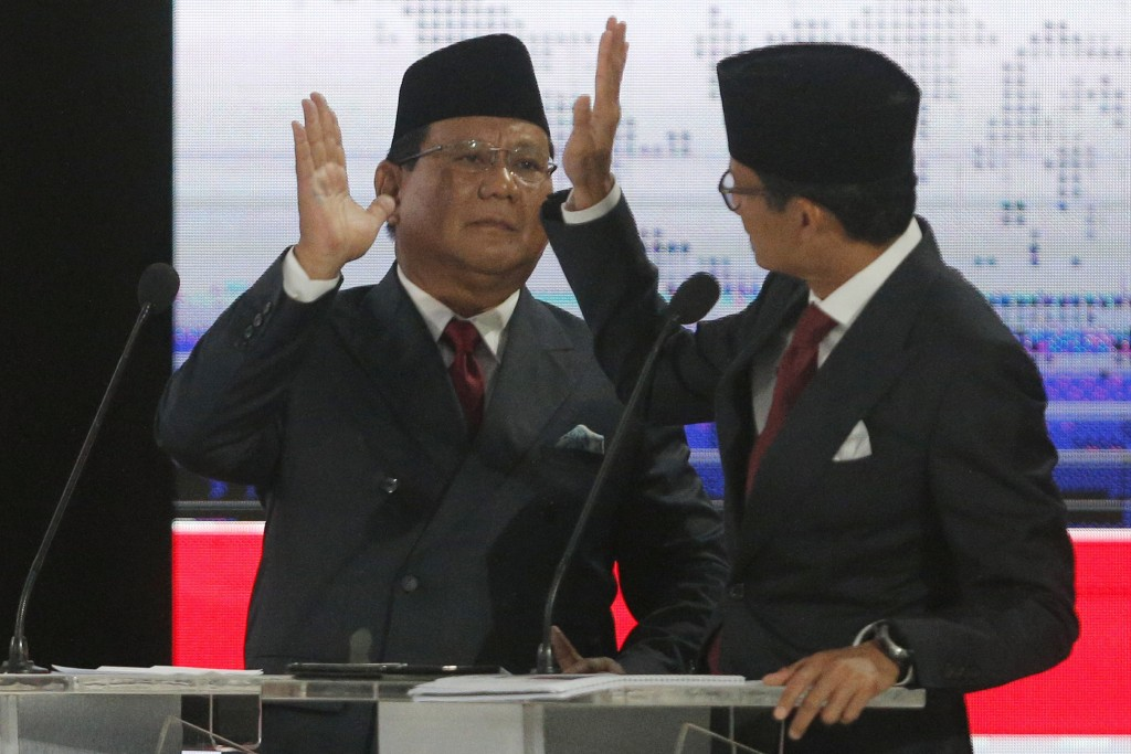 In this Saturday, April 13, 2019, file photo, Indonesian presidential candidate Prabowo Subianto, left, gestures with running mate Sandiaga Uno, right