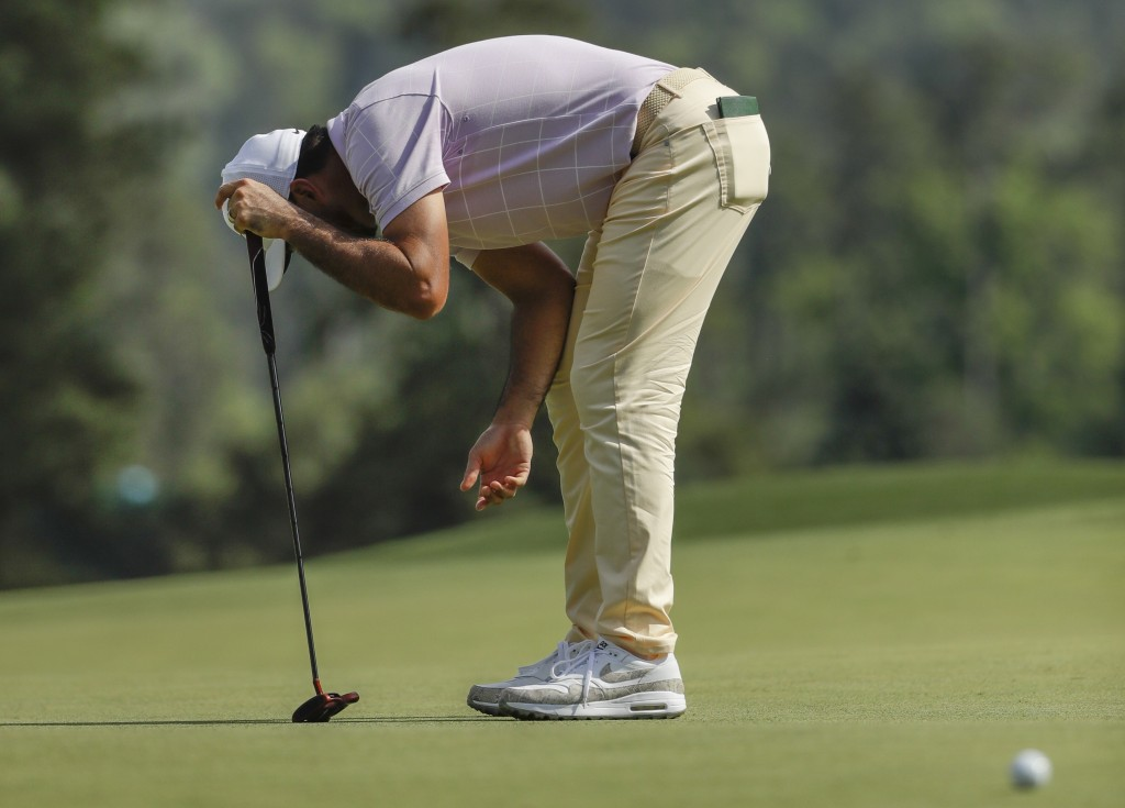 Jason Day, of Australia, reacts to a putt on the eighth hole during the third round for the Masters golf tournament Saturday, April 13, 2019, in Augus...