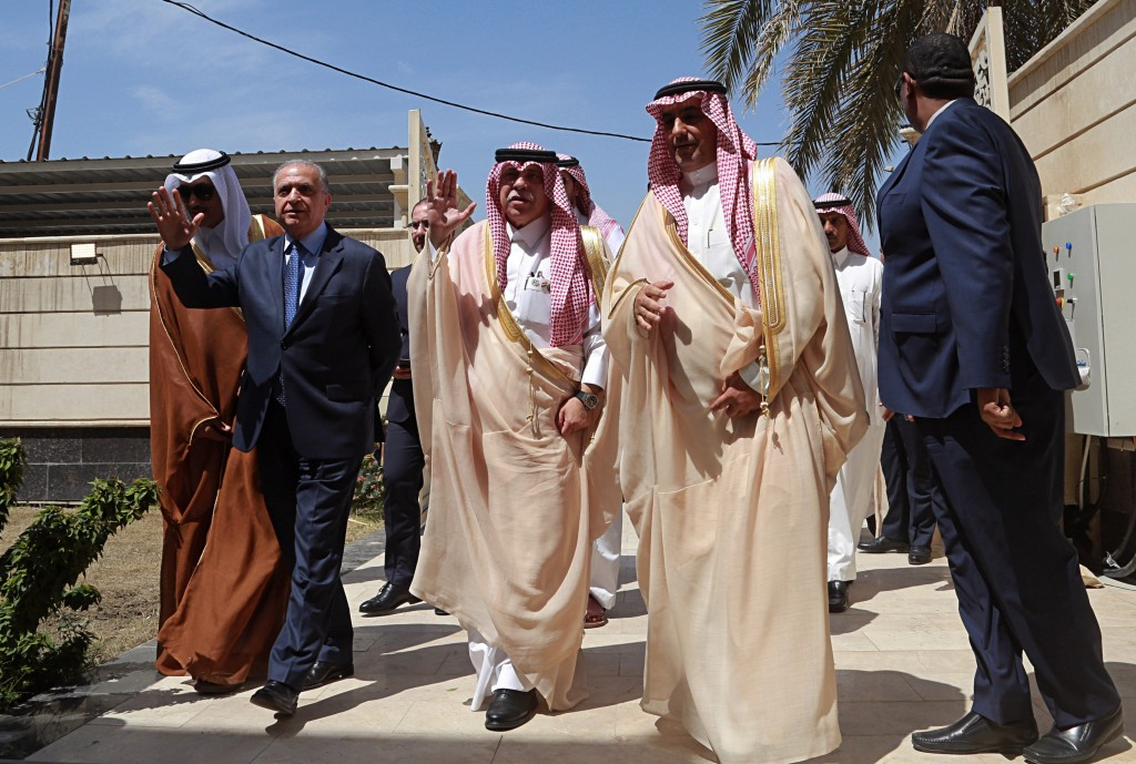 FILE - In this April 4, 2019 file photo, Saudi Minister of Commerce and Investment, Majid bin Abdullah Al Qasabi, center, and Iraq Foreign Minister Mo...