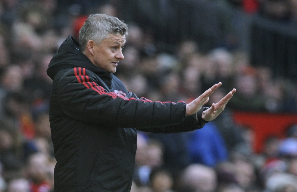 Manchester United manager Ole Gunnar Solskjaer gestures during the English Premier League soccer match between Manchester United and West Ham United a...