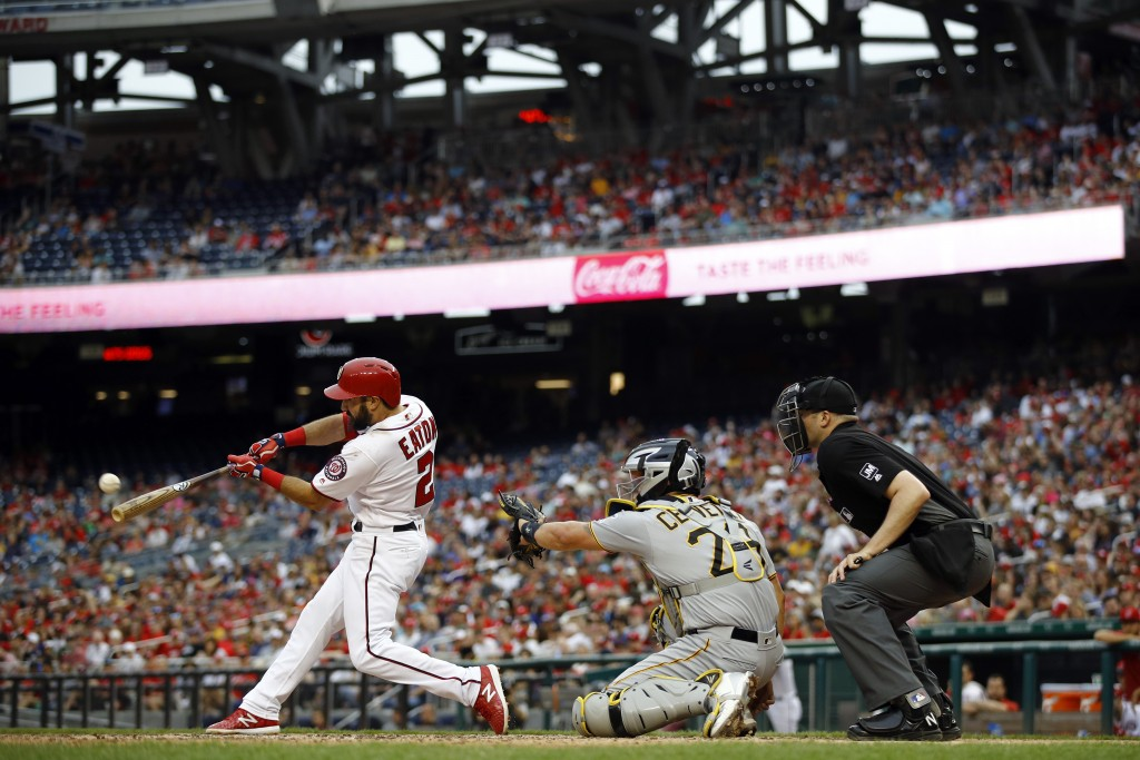 Washington Nationals' Adam Eaton, left, hits a solo home run in front of Pittsburgh Pirates catcher Francisco Cervelli, center, and umpire Nic Lentz i