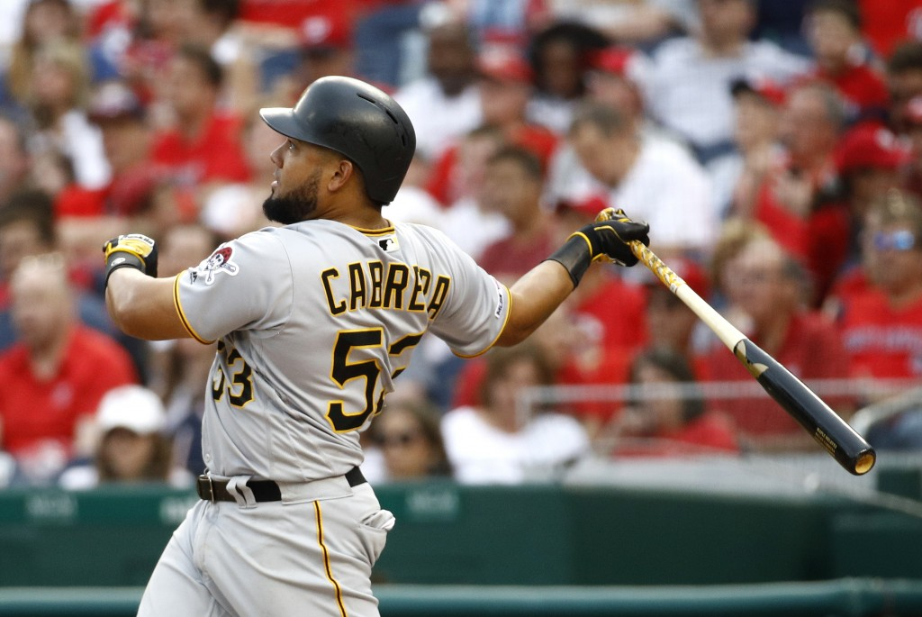 Pittsburgh Pirates' Melky Cabrera watches his solo home run in the sixth inning of a baseball game against the Washington Nationals, Saturday, April 1...