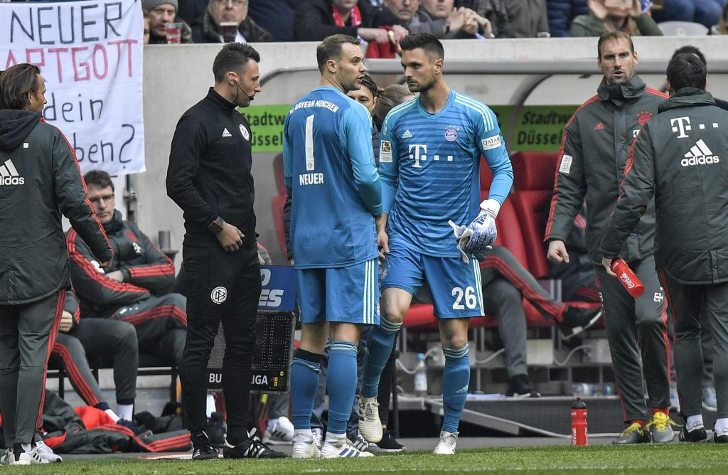 Bayern goalkeeper Manuel Neuer, left, leaves the pitch injured for Bayern goalkeeper Sven Ulreich, right, during the German Bundesliga soccer match be