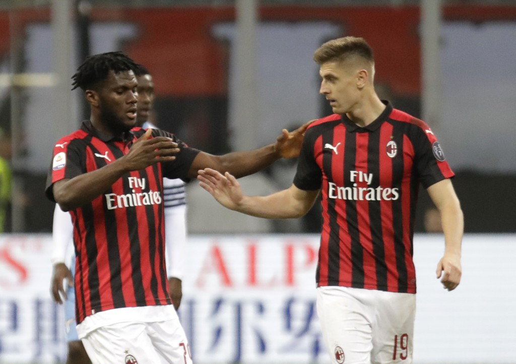 AC Milan's Franck Kessie, left, celebrates after scoring the opening goal with his teammate Krzysztof Piatek during the Serie A soccer match between A...