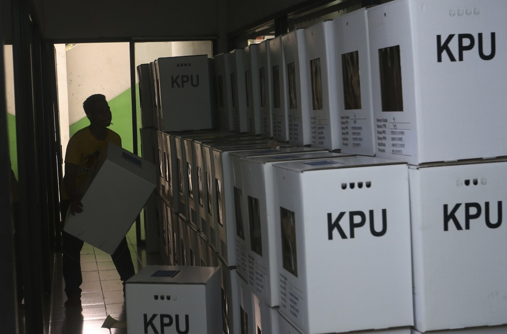 A worker prepares ballot boxes to be distributed to polling stations in Jakarta, Indonesia, Monday, April 15, 2019. The world's third-largest democrac
