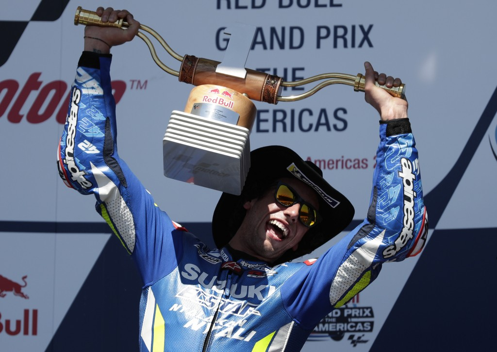 CORRECTS TO RINS OF SPAIN NOT AUSTRALIA = Alex Rins, of Spain, celebrates with his trophy after winning the Grand Prix of the Americas motorcycle race