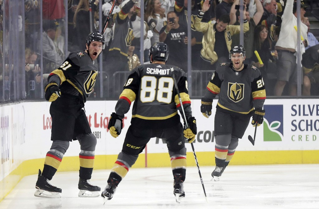 Vegas Golden Knights right wing Mark Stone, left, celebrates after scoring against the San Jose Sharks during the first period of Game 3 of an NHL fir