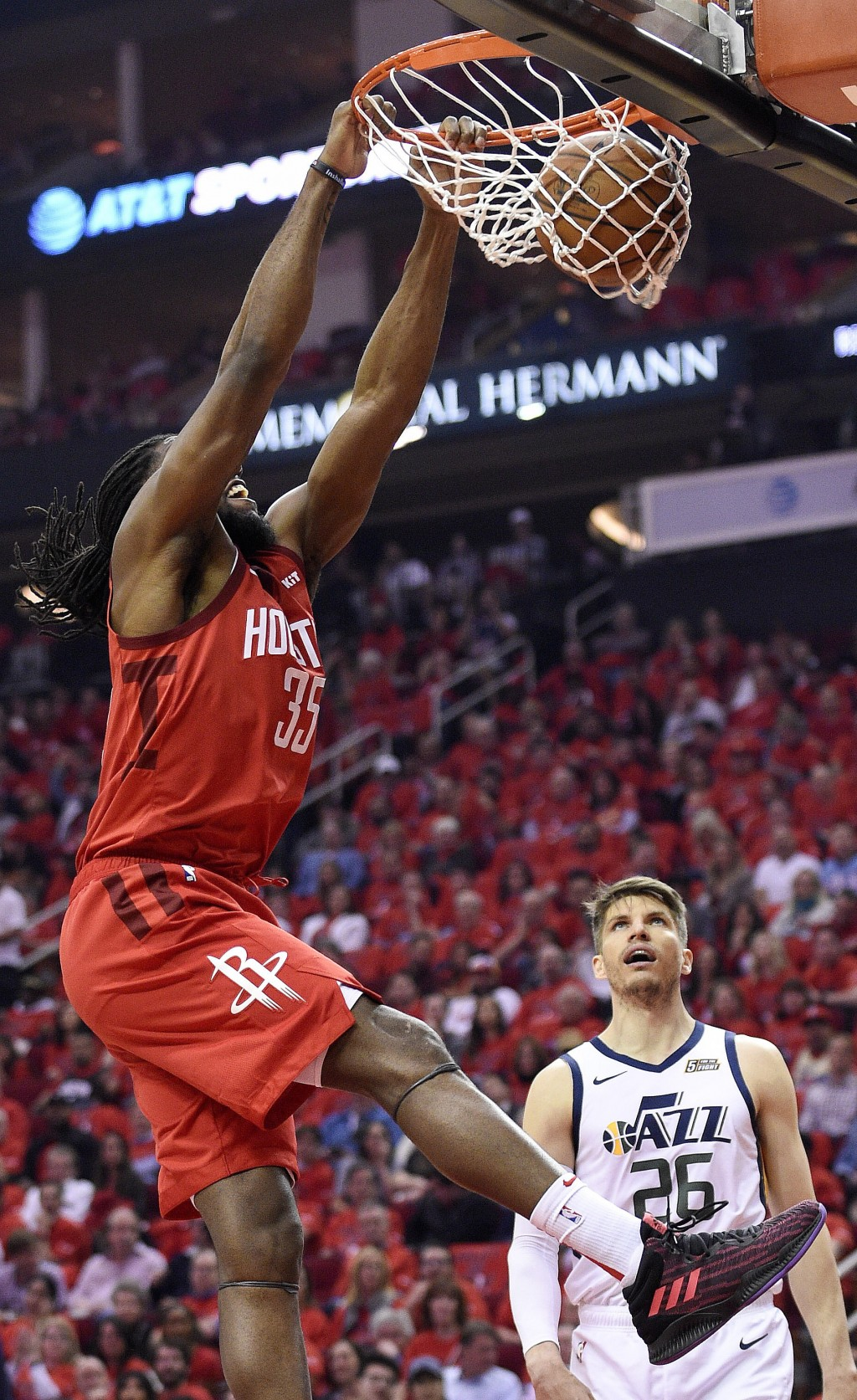 Houston Rockets forward Kenneth Faried, left, dunks as Utah Jazz guard Kyle Korver (26) watches during the first half of Game 1 of an NBA basketball f
