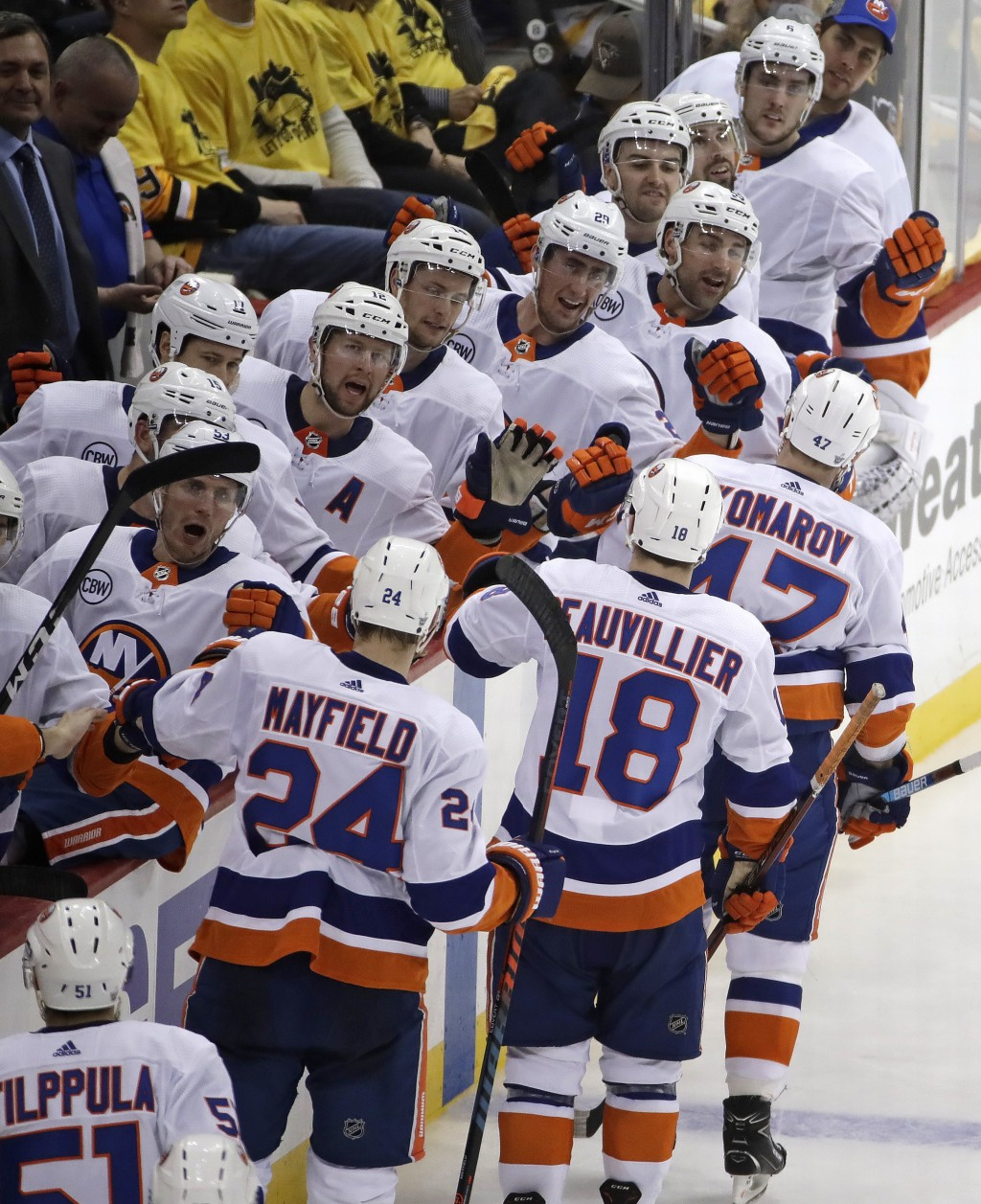 New York Islanders' Leo Komarov (47) leads the way back to the bench after his goal during the third period in Game 3 of an NHL first-round hockey pla