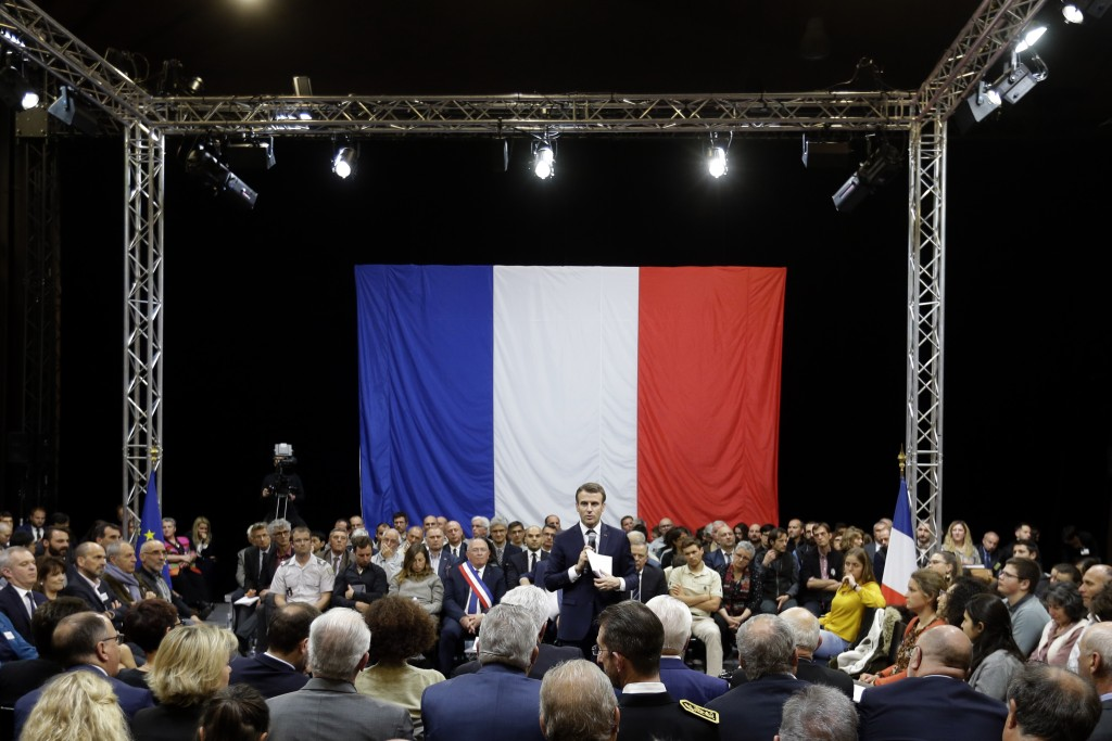 "FILE - In this March 7, 2019 file photo, French President Emmanuel Macron attends a meeting as part of the ""great national debate"" on ecology matters"