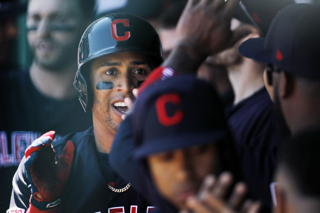 Cleveland Indians' Leonys Martin is congratulated in the dugout after hitting a solo home run in the first inning of a baseball game against the Kansa
