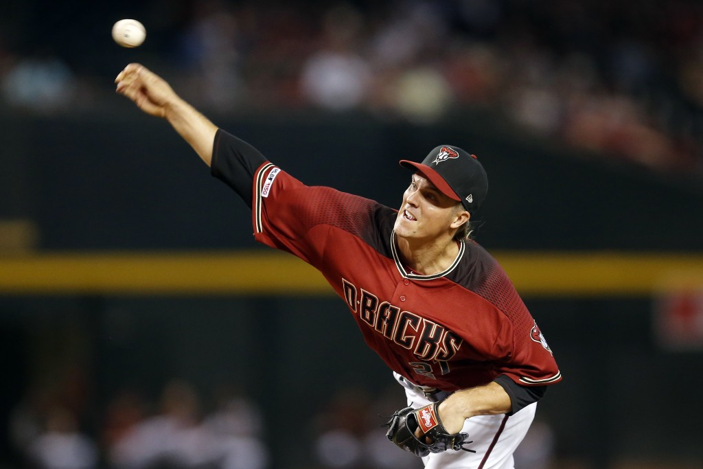 Arizona Diamondbacks pitcher Zack Greinke throws in the first inning during a baseball game against he San Diego Padres, Sunday, April 14, 2019, in Ph