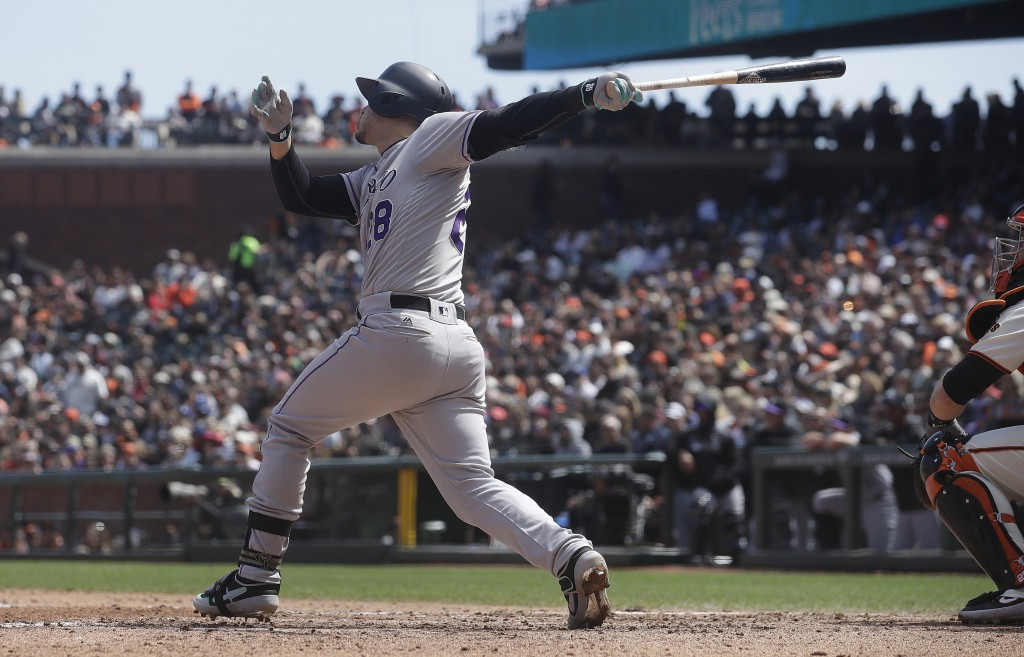 Colorado Rockies' Nolan Arenado hits a three-run home run against the San Francisco Giants during the fifth inning of a baseball game in San Francisco
