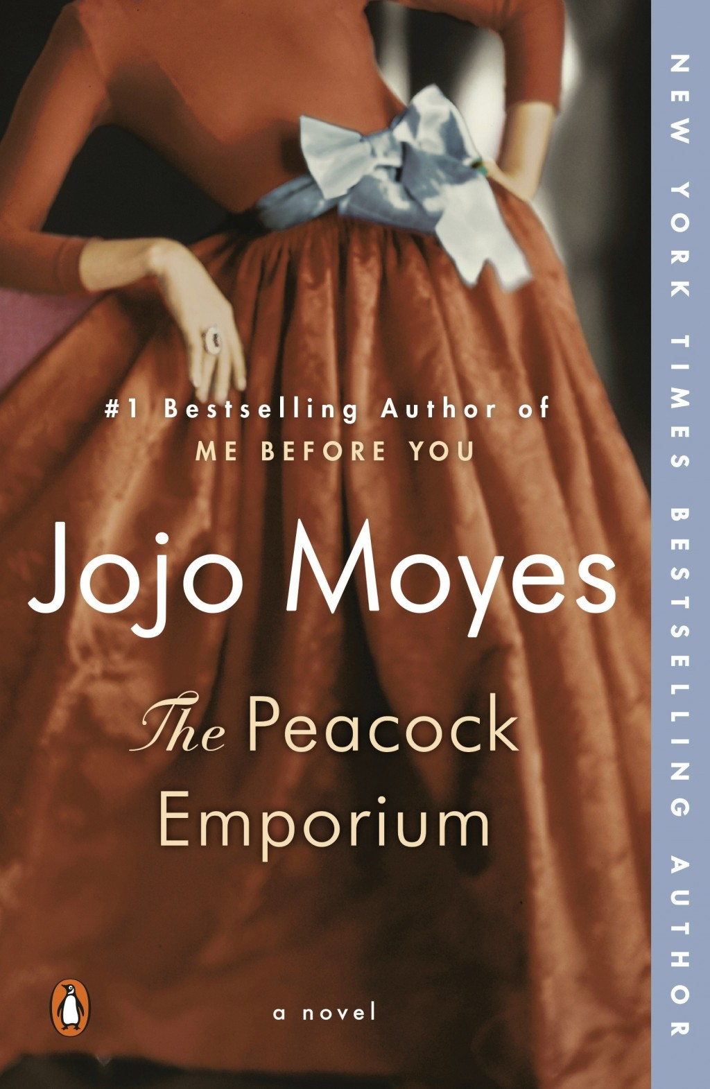 "This cover image released by Penguin Books shows ""The Peacock Emporium,"" a novel by Jojo Moyes. (Penguin via AP)"