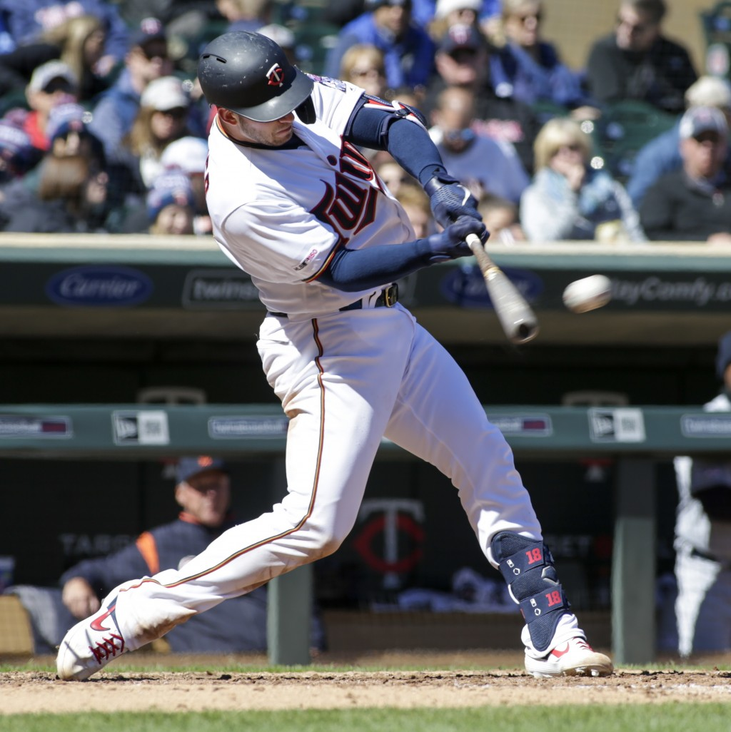 Minnesota Twins' Mitch Garver (18) connects for a double during the fifth inning of a baseball game against the Detroit Tigers Sunday, April 14, 2019,...