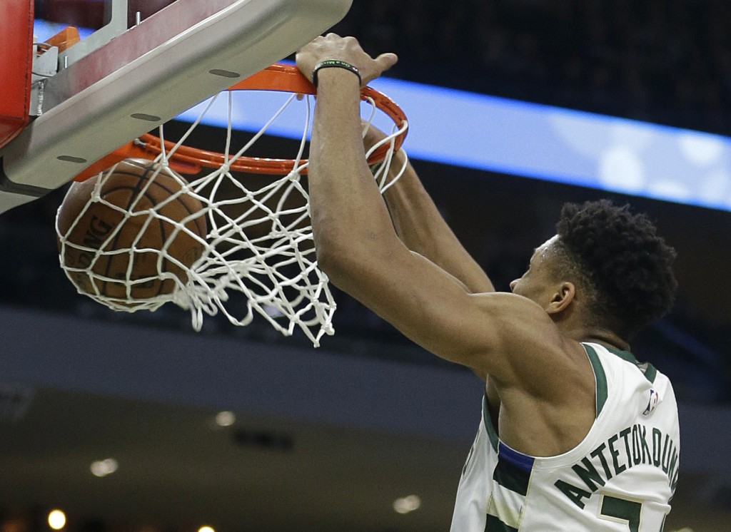 Milwaukee Bucks' Giannis Antetokounmpo dunks during the second half of Game 1 of an NBA basketball first-round playoff series against the Detroit Pist