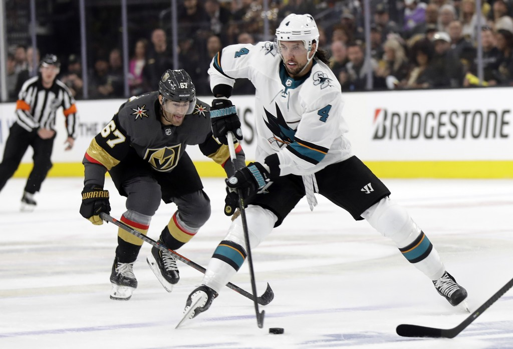 Vegas Golden Knights left wing Max Pacioretty (67) defends as San Jose Sharks defenseman Brenden Dillon (4) looks to pass during the first period of G