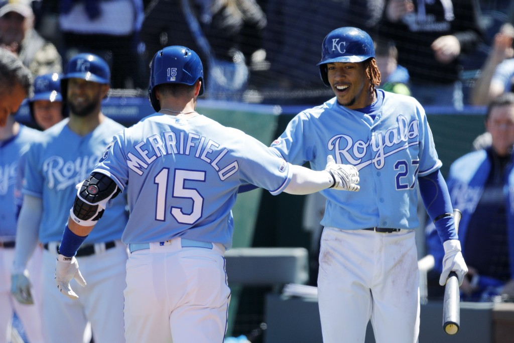 Kansas City Royals' Whit Merrifield (15) is congratulated by Adalberto Mondesi (27) after hitting a home run in the second inning of a baseball game a